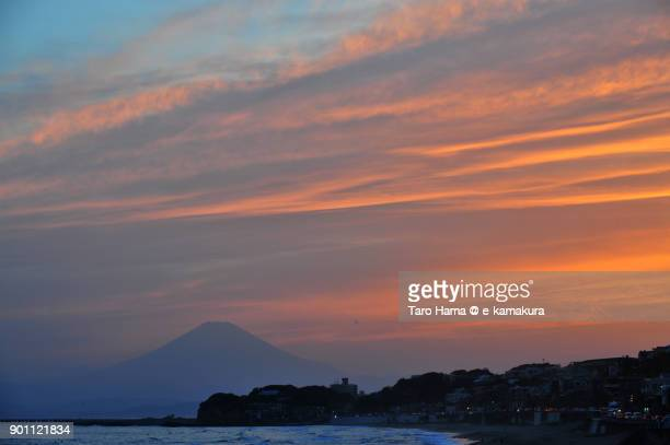 Orange-colored clouds on Mt. Fuji in Japan, after sunset