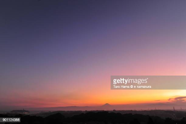 Orange-colored clouds on Mt. Fuji in Japan after sunset