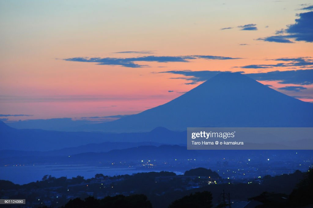 Orange-colored clouds on Mt. Fuji in Japan after sunset : ストックフォト