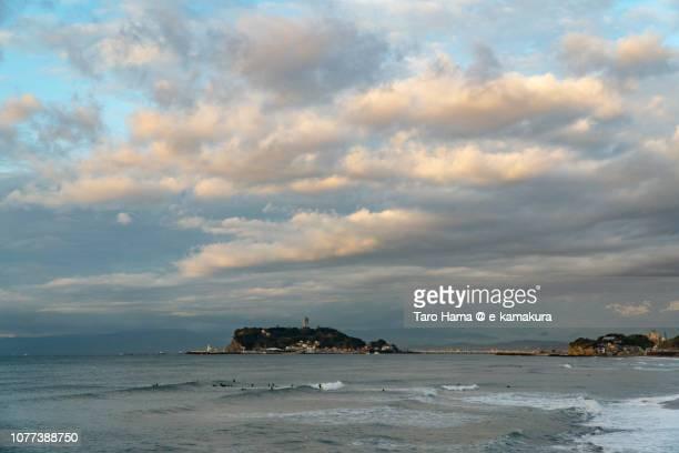 Orange-Colored morning clouds on Enoshima Island and Sagami Bay, Pacific Ocean in Kanagawa prefecture in Japan