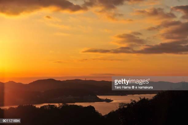 Orange-colored morning clouds on Miura Peninsula and Sagami Bay in Kanagawa prefecture in Japan