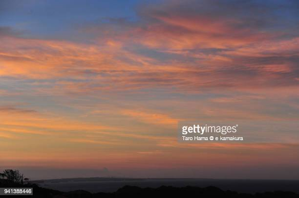 Orange-colored morning clouds on Sagami Bay, Northern Pacific Ocean in Japan