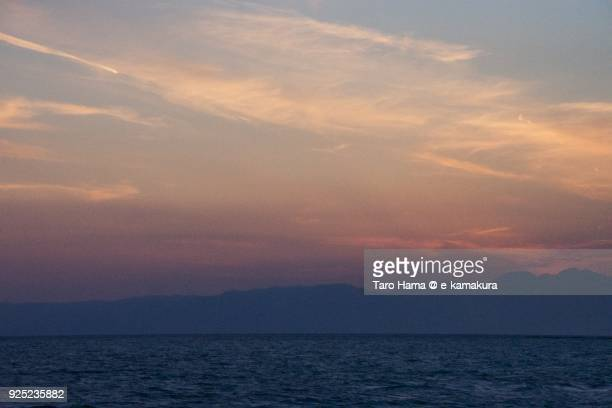 Orange-colored sunset clouds on Izu Peninsula, Sagami Bay in Kanagawa prefecture in Japan