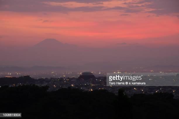 Orange-colored sunset clouds on Mt. Fuji and Fujisawa, Chigasaki and Hiratsuka cities in Japan