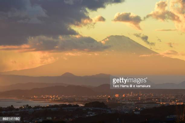 Orange-colored sunset clouds on Mt. Fuji and Sagami Bay in Japan