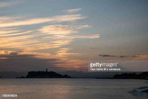 Orange-colored sunset clouds on Mt. Fuji and Sagami Bay, Pacific Ocean in Japan