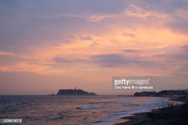 Orange-colored sunset clouds on Mt. Fuji, Enoshima Island and Sagami bay in Japan