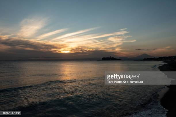 Orange-colored sunset clouds on Mt. Fuji, Enoshima Island and Sagami Bay, Pacific Ocean in Japan