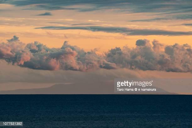 Orange-colored sunset clouds on Oshima Island in Tokyo and Sagami Bay in Kanagawa prefecture in Japan