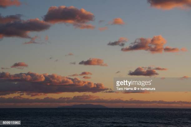 Orange-colored sunset clouds on Sagami Bay and Tokyo Oshima in Japan