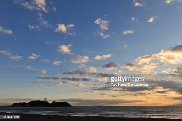 Orange-colored sunset clouds on Sagami Bay, Northern Pacific Ocean, and Enoshima Island in Fujisawa city in Kanagawa prefecture in Japan