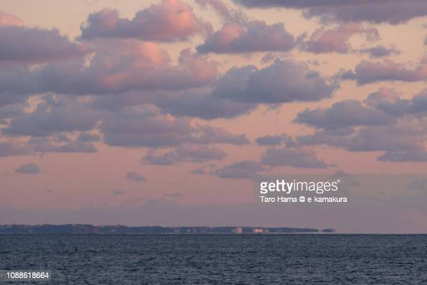 Orange-colored sunset clouds on Sagami Bay, Northern Pacific Ocean in Japan