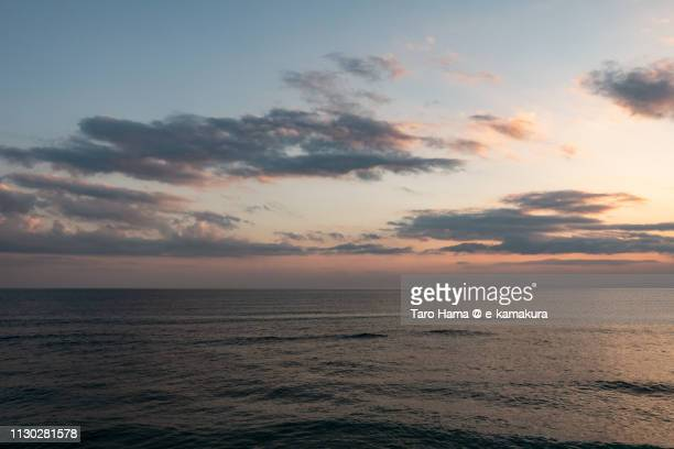 Orange-colored sunset clouds on Sagami Bay, Pacific Ocean in Kamakura city in Kanagawa prefecture in Japan