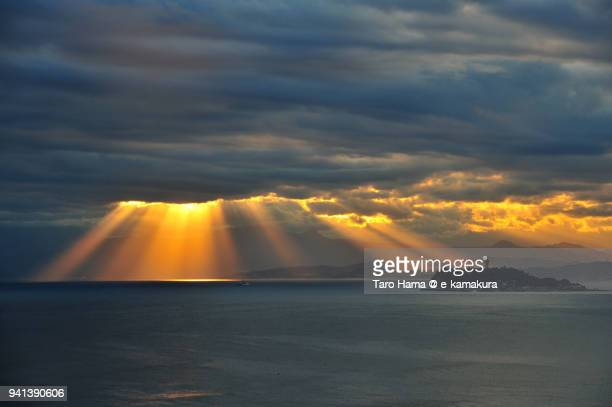 orange-colored sunset strong sunbeam on enoshima island and sagami bay, northern pacific ocean in japan - zushi kanagawa stock photos and pictures