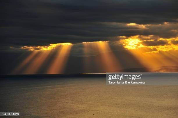 orange-colored sunset strong sunbeam on sagami bay, northern pacific ocean in japan - zushi kanagawa stock photos and pictures