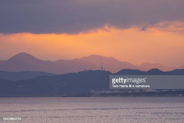 Orange-colored sunset sunbeam on Hakone mountains, and Oiso town and Hiratsuka city in Kanagawa prefecture in Japan