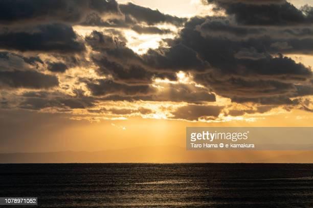 Orange-colored sunset sunbeam on Izu Peninsula and Sagami Bay, Northern Pacific Ocean in Japan