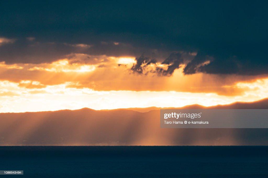 Orange-colored sunset sunbeam on Izu Peninsula and Sagami Bay, Pacific Ocean in Japan : Stock Photo