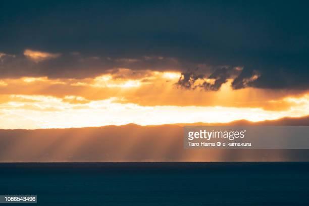 Orange-colored sunset sunbeam on Izu Peninsula and Sagami Bay, Pacific Ocean in Japan