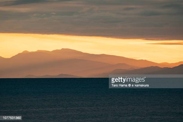 Orange-colored sunset sunbeam on Mt. Amagi in Izu Peninsula, Shizuoka prefecture and Sagami Bay in Japan