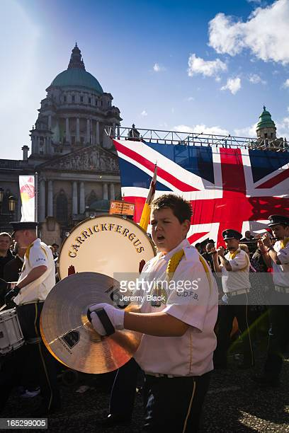 Orangemen march past City Hall in the centre of Belfast, Northern Ireland on September 29, 2012. Up to 30,000 people took part in the six-mile march...