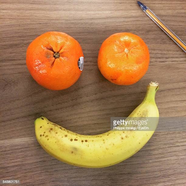 Oranges And Banana On Wooden Table