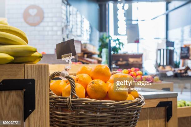 Oranges and bananas in supermarket