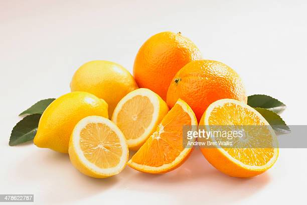 Oranges and lemons with fresh leaves