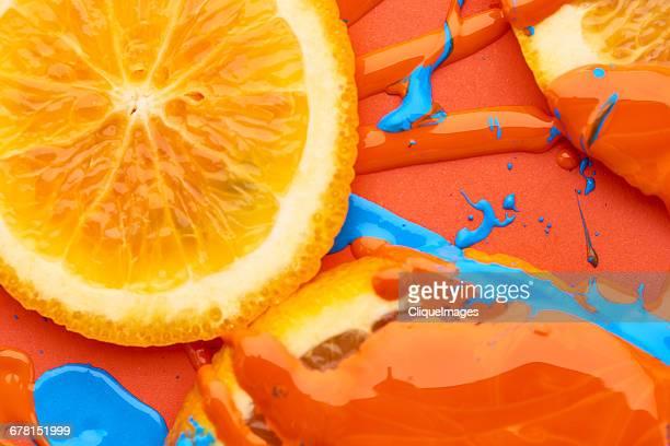 oranges and paint - cliqueimages photos et images de collection