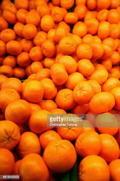 Oranges are displayed for sale at a shop on April 1, 2014 in Northwich, United Kingdom. Researchers at University College London have said that...