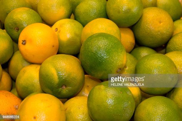 Oranges are pictured at the fruit and vegetable department of an 'O Marche' supermarket in SaintFrancois on the French overseas territory of...