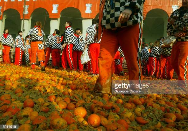 Oranges are seen on the ground during the Orange Battle at the 2005 Ivrea Carnival on February 6 2005 in Ivrea Italy During the Orange Battle 3600...