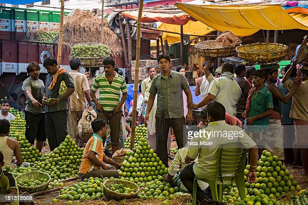 Oranges at the wholesale market are sold like this, they are placed on top of each other in pyramid shapes,so the buyer knows how many oranges he...