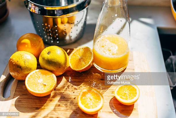 Oranges for juice on a cutting board