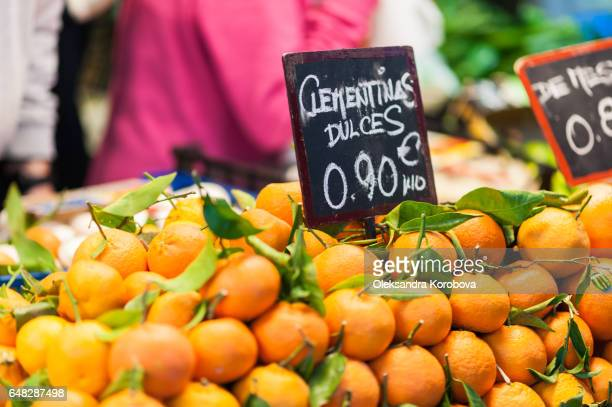 Oranges for sale on display on a counter