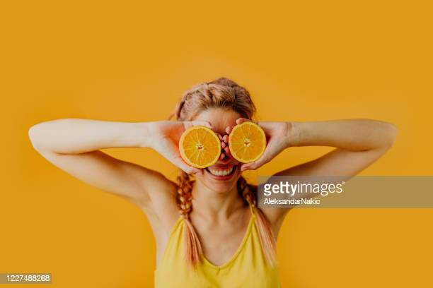oranges in her eyes - orange fruit stock pictures, royalty-free photos & images