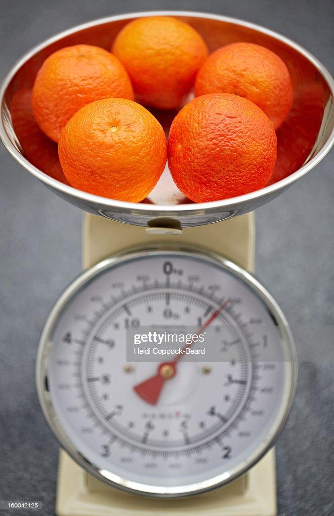 Oranges in scales : Stock Photo