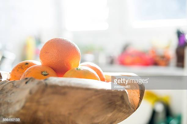Oranges in wooden bowl, kitchen