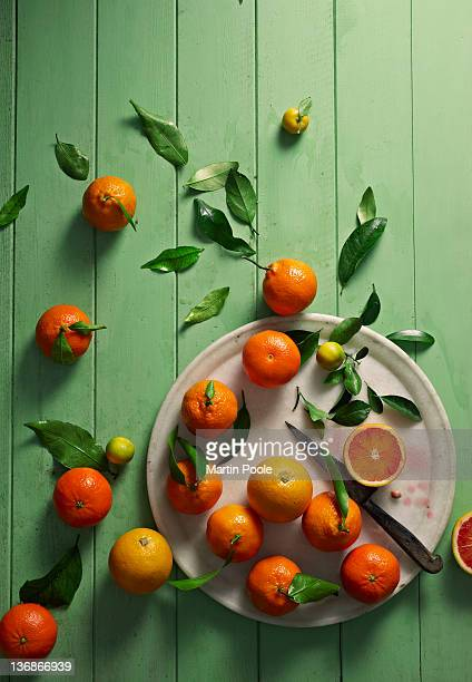 oranges overhead on table - orange fruit stock pictures, royalty-free photos & images