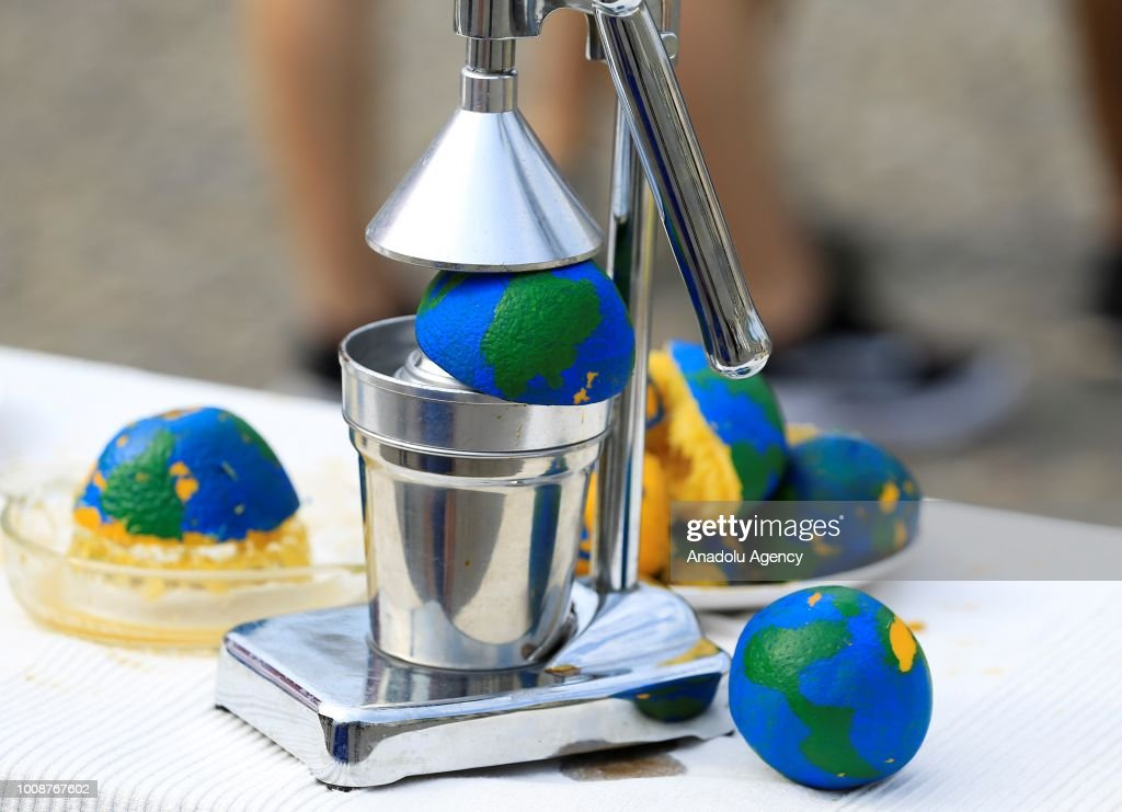 oranges painted as a globe are seen during a demonstration held by