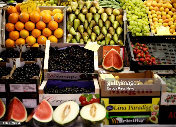 Oranges pears melons watermelons grapes lemons cherries and strawberries in a market on July 24 2019 in Madrid Spain