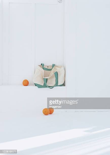 Oranges rolled out of totebag
