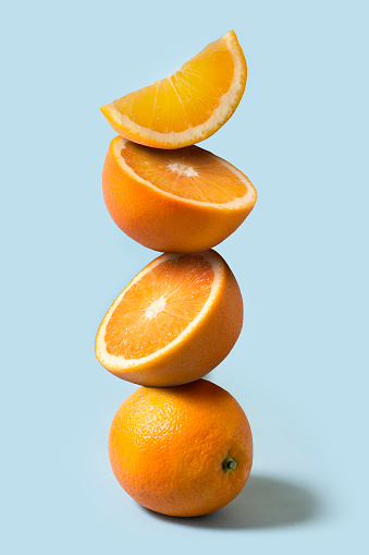 Oranges stack on light blue background. - gettyimageskorea
