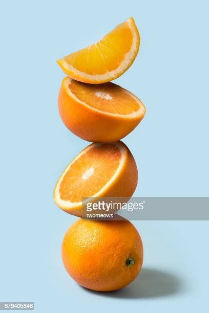 Oranges stack on light blue background.