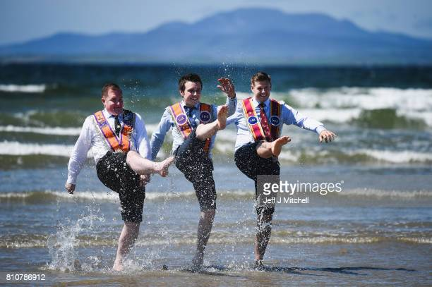 Orangmen take a walk onto the beach as they take part in the annual pre Twelfth of July parade held in Rossnowlagh on July 8 2017 in Donegal Ireland...