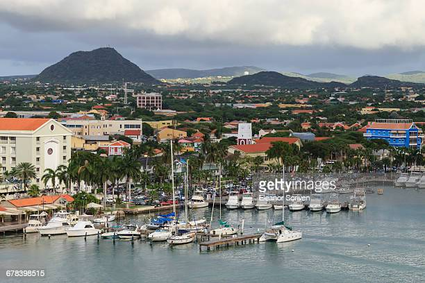 oranjestad under heavy skies, elevated view from the cruise ship terminal, oranjestad, aruba, antilles, west indies, caribbean, central america - oranjestad stockfoto's en -beelden