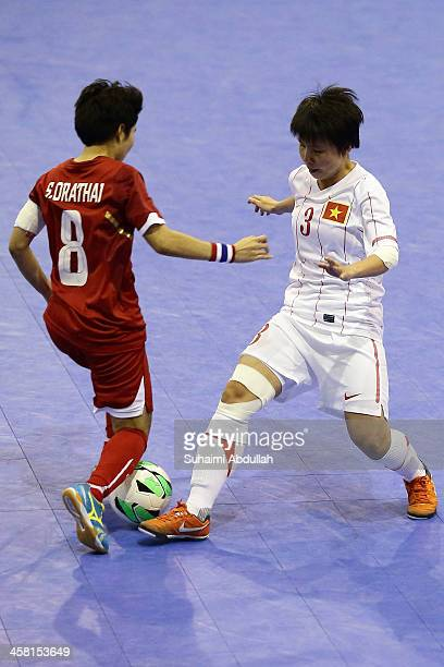 Orathai Srimanee of Thailand and Ngoc Hoa Trinh of Vietnam challenge for the ball during the women's futsal final between Thailand and Vietnam during...