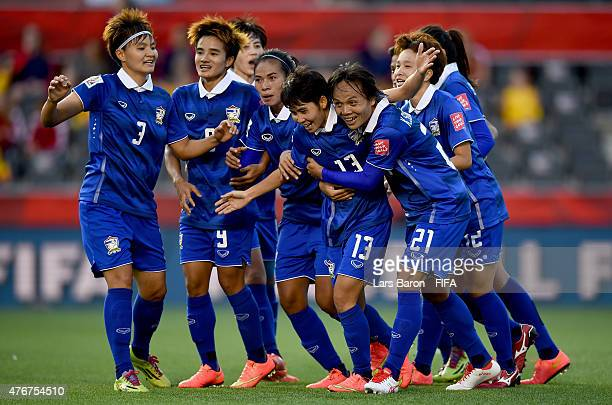 Orathai Srimanee of Thailand celebrates with team mates after scoring her teams second goal during the FIFA Women's World Cup 2015 Group B match...