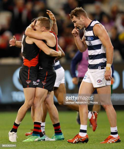 Orazio Fantasia and Devon Smith of the Bombers celebrate during the 2018 AFL round nine match between the Essendon Bombers and the Geelong Cats at...