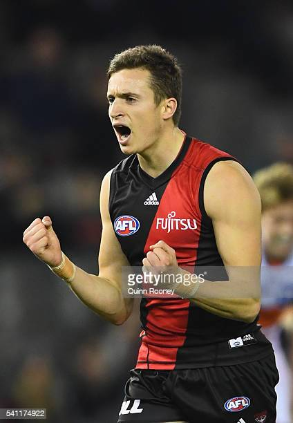 Orazio Fantasia of the Bombers celebrates after kicking a goal during the round 13 AFL match between the Essendon Bombers and the Greater Western...